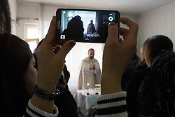 "Father Adday celebrates mass at an apartment in Kirsehir, Turkey.<br /> ""A mass in a house is more like a family. Father and children sharing the glory of God"". ""I would say it is like watching a film in a movie theater versus watching it at home with your family,"" Father Adday explains."