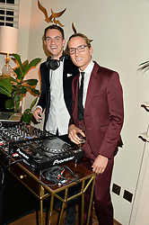 Left to right, VISCOUNT ERLEIGH and OLIVER PROUDLOCK at a private view of the Beulah Winter Autumn Winter collection entitled 'Chrysalis' held at The South Kensington Club, London SW7 on 24th September 2015.