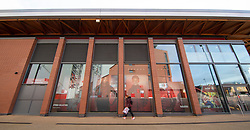 LIVERPOOL, ENGLAND - Tuesday, March 17, 2020: A woman walks past the closed LFC retail store at a near deserted Anfield, home of Champions-elect Liverpool Football Club, after the suspension of all football due to the Coronavirus (COVID-19) and Liverpool's decision to close it's Boot Room cafe and official stores. (Pic by David Rawcliffe/Propaganda)