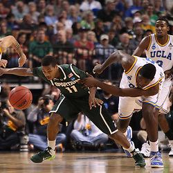 Mar 17, 2011; Tampa, FL, USA; UCLA Bruins center Anthony Stover (0) fouls Michigan State Spartans guard Keith Appling (11) during the first half of the second round of the 2011 NCAA men's basketball tournament at the St. Pete Times Forum.  Mandatory Credit: Derick E. Hingle