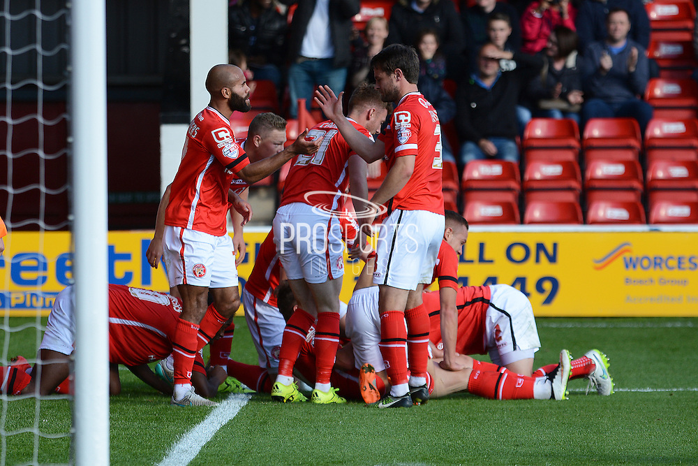 Walsall players celebrate Tom Bradshaw goal during the Sky Bet League 1 match between Walsall and Doncaster Rovers at the Banks's Stadium, Walsall, England on 12 September 2015. Photo by Alan Franklin.