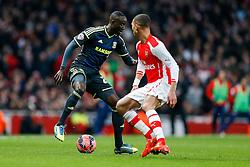 Albert Adomah of Middlesbrough is challenged by Kieran Gibbs of Arsenal - Photo mandatory by-line: Rogan Thomson/JMP - 07966 386802 - 15/02/2015 - SPORT - FOOTBALL - London, England - Emirates Stadium - Arsenal v Middlesbrough - FA Cup Fifth Round Proper.