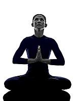 woman exercising Padmasana lotus pose yoga silhouette shadow white background