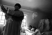 A nurse preparing to attend to a patient at the Footprints Hospice 14 August 2009 Orlando East Soweto, South Africa. Footprints Hospice was opened by the Soweto Retired Professional Society (SRPS)  in August 4 2004 by retired nurses from Chris Hani Baragwanath Hospital. .