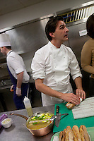 Chef Yannick Alleno of the restaurant le Meurice - making a hotdog Tete de Veau- cooked in a bouilion de volaiile and served with a sauce grebiche- ..photograph by Owen Franken for the NY Times..February 9, 2012....