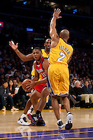 15 January 2010: Guard Eric Gordon of the Los Angeles Clippers turns to get out of a double team by Kobe Bryant and Derek Fisher of the Los Angeles Lakers during the first half of the Lakers 126-86 victory over the Clippers at the STAPLES Center in Los Angeles, CA.
