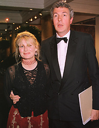 MR & MRS HENRY WYNDHAM, he is chairman of Sotheby's in Europe, at a dinner in London on 19th May 1999.MSF 1