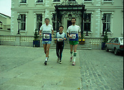 Dublin City Marathon.  (R90)..1988..31.10.1988..10.31.1988..31st October 1988..The 9th running of the annual Dublin City Marathon took place in Dublin today. This years event was sponsored by Mars. The mens race was won by John Griffin, Ireland and the ladies race was won by Moira O'Neill, Great Britain. Many hundreds of fun runners take part in this race and they generate millions for the many charities which seek help at this time...Pictured outside the Mansion House, Dublin. Before the start of the marathon,representating Standard Chartered Bank were Tom Wrafter, Sue Blakeway and Seamus Belton.