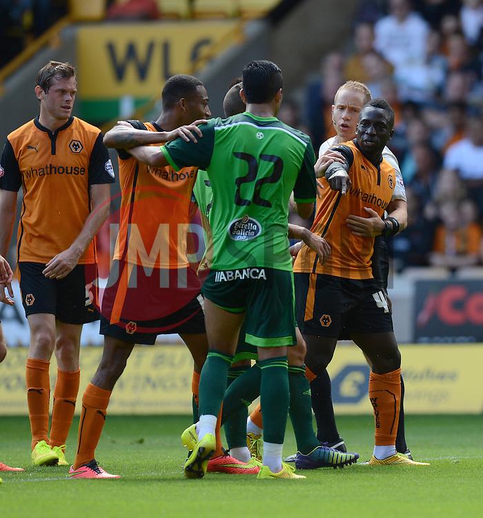 Wolverhampton's Nouha Dicko argues with Celta Vigo's Gustavo Cabral  - Photo mandatory by-line: Alex James/JMP - Tel: Mobile: 07966 386802 2/08/2014 - SPORT - FOOTBALL -  Wolverhampton - Molineux Stadium  -   Wolverhampton vs  Celta Vigo - preseason