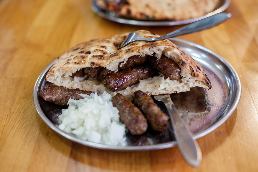 Ćevapi or ćevapčići is a grilled dish of minced meat at the quarter Baščaršija - which is Sarajevo's old bazaar and the historical and cultural center of the Bosnian capital city.