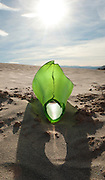 Green glass bottle in Mesquite Flat Sand Dunes, in Death Valley National Park near Stovepipe Wells