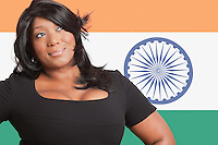 Thoughtful casual mixed race woman over Indian flag