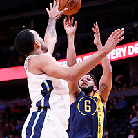 03 April 2018: Indiana Pacers guard Cory Joseph (6) takes a jump shot over Denver Nuggets forward Trey Lyles (7) during the Denver Nuggets 107-104 victory over the Indiana Pacers, at the Pepsi Center, Denver, Colorado, USA.