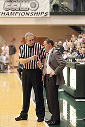 01 March 2014:  An official and Mike Schauer have a conversation during an NCAA mens division 3 CCIW  Championship basketball game between the Wheaton Thunder and the Illinois Wesleyan Titans in Shirk Center, Bloomington IL