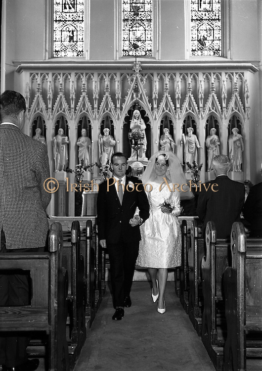 28/07/1962<br /> 07/28/1962<br /> 28 July 1962 <br /> Wedding of Mr Desmond F. English, Landscape Cresent, Churchtown and Miss Blanche O'Brien Oakley Park, Blackrock at St John the Baptist Church, Blackrock and Ross's Hotel Dun Laoghaire, Dublin. Image shows the bride and groom walking down the aisle of the church after the ceremony.