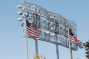 LOS ANGELES, CA - MAY 28:  Flags fly at the top of the park in honor of Memorial Day while in front of stadium lights prior to the Los Angeles Dodgers game against the Milwaukee Brewers on Monday, May 28, 2012 at Dodger Stadium in Los Angeles, California. The Brewers won the game 3-2. (Photo by Paul Spinelli/MLB Photos via Getty Images)