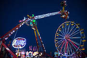 WASHINGTON, USA - August 19: As night falls over the Montgomery County Agricultural Fair the amusement rides are lit up with flashing and strobing colored lights in Gaithersburg, Md., USA on August 19, 2017.