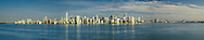 Low-angle aerial panorama of the Miami skyline, from the east looking over Biscayne Bay, featuring the Brickell waterfront. This version is watermarked, contact us to license and clean version.