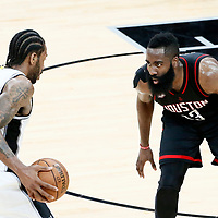 01 May 2017: Houston Rockets guard James Harden (13) defends on San Antonio Spurs forward Kawhi Leonard (2) during the Houston Rockets 126-99 victory over the San Antonio Spurs, in game 1 of the Western Conference Semi Finals, at the AT&T Center, San Antonio, Texas, USA.