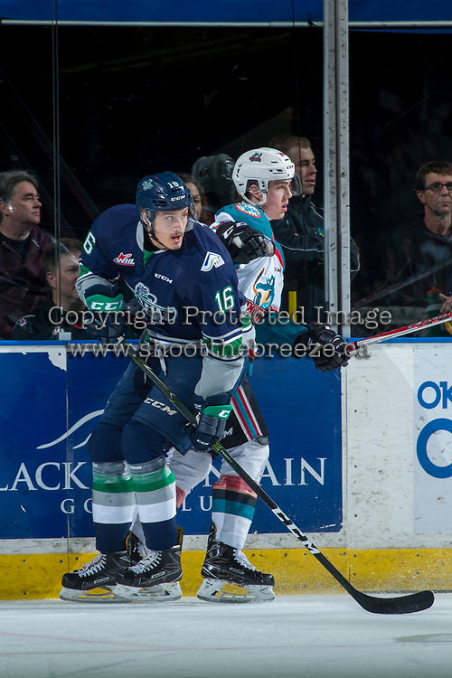 KELOWNA, CANADA - APRIL 30: Kole Lind #16 of the Kelowna Rockets checks Alexander True #16 of the Seattle Thunderbirds on April 30, 2017 at Prospera Place in Kelowna, British Columbia, Canada.  (Photo by Marissa Baecker/Shoot the Breeze)  *** Local Caption ***