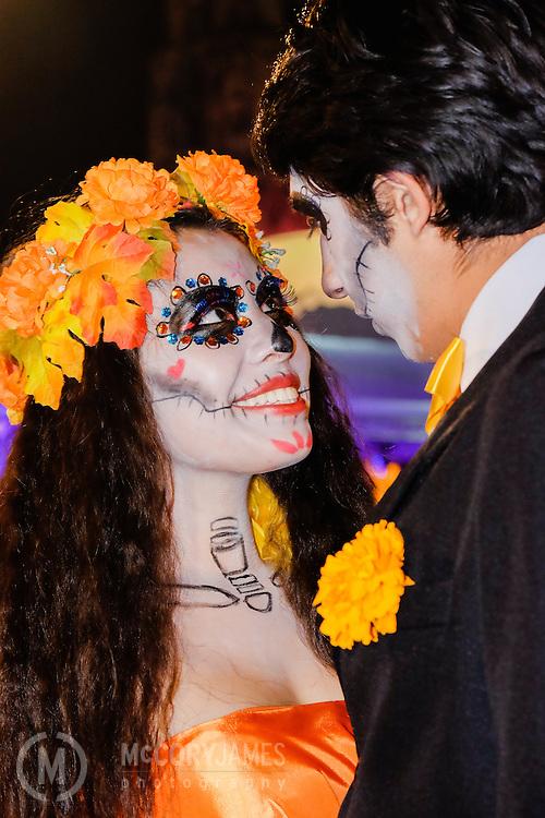 A couple dressed up for Dia de los Muertos
