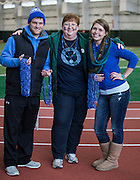 From left to right, Shawn Adams, Cheryl How, and Danielle Godby pose as they hold blue ribbon necklaces for participants in the Blue Circle for Diabetes event at the Walter Fieldhouse at Ohio University on Friday, November 14, 2014.