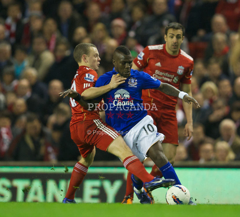 LIVERPOOL, ENGLAND - Tuesday, March 13, 2012: Liverpool's Jay Spearing and Everton's Royston Drenthe during the Premiership match at Anfield. (Pic by David Rawcliffe/Propaganda)