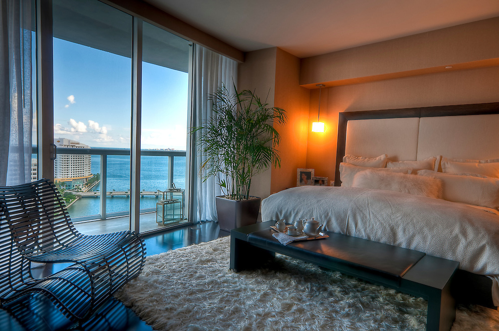 View of luxury apartment bedroom with view to the bay.