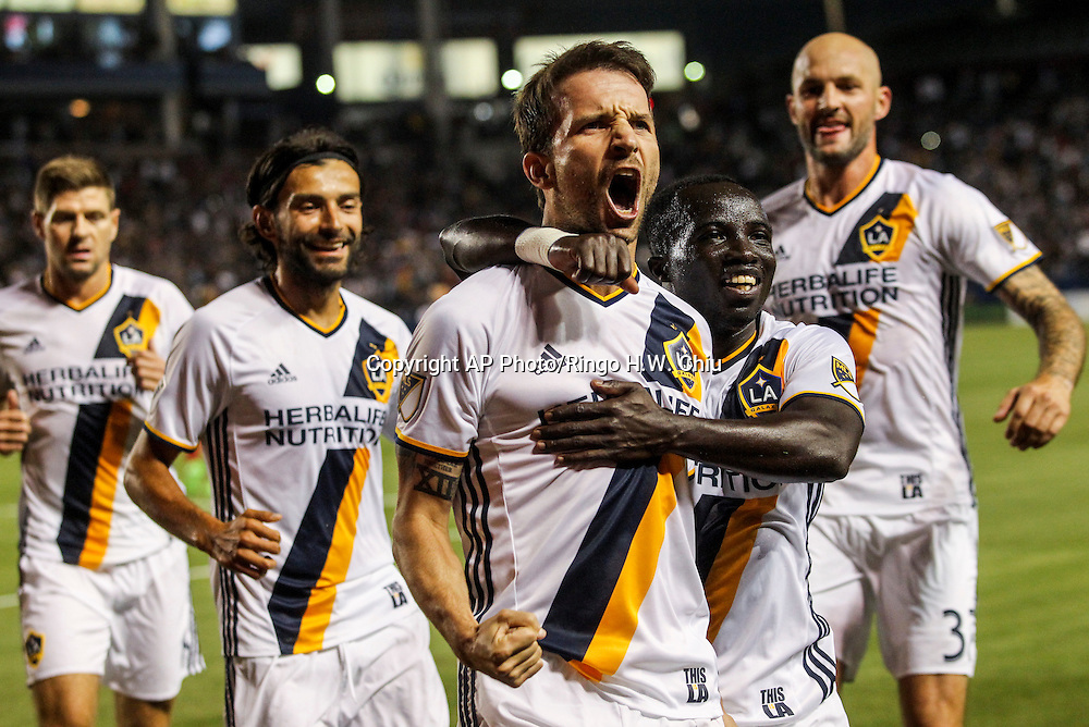 Los Angeles Galaxy midfielder Mike Magee, center, celebrate his goal assisted by his teammate Emmanuel Boateng, 2nd right, in the first half of an MLS soccer game in Carson, Calif., Saturday, April 23, 2016. (AP Photo/Ringo H.W. Chiu)