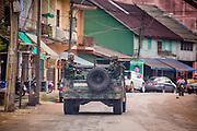 28 OCTOBER 2012 - SUNGAI KOLOK, NARATHIWAT, THAILAND:  Thai soldiers in HUMVEEs patrol a residential section of Sungai Kolok, Thailand. More than 5,000 people have been killed and over 9,000 hurt in more than 11,000 incidents, or about 3.5 a day, in Thailand's three southernmost provinces and four districts of Songkhla since the insurgent violence erupted in January 2004, according to Deep South Watch, an independent research organization that monitors violence in Thailand's deep south region that borders Malaysia.   PHOTO BY JACK KURTZ