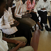 Dr. Julian Atim, co-founder of Students for Equity in Helathcare, discusses issues with medical students at Mulago Hospital.