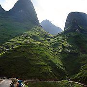 A stretch of highway in Ha Giang, Vietnam's northernmost province, 06 June, 2007. As cities like Hanoi and Ho Chi Minh roar with Vietnam's economic boom, Ha Giang remains a quiet, serene and beautiful mountain backwater along the Chinese border. ....