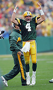 GREEN BAY, WI - SEPTEMBER 25:  Quarterback Brett Favre #4 of the Green Bay Packers celebrates after throwing a 37 yard touchdown pass to teammate Robert Ferguson #89 in the first quarter against the Tampa Bay Buccaneers at Lambeau Field on September 25, 2005 in Green Bay, Wisconsin. The Buccaneers defeated the Packers 17-16. ©Paul Anthony Spinelli *** Local Caption *** Robert Ferguson;Brett Favre