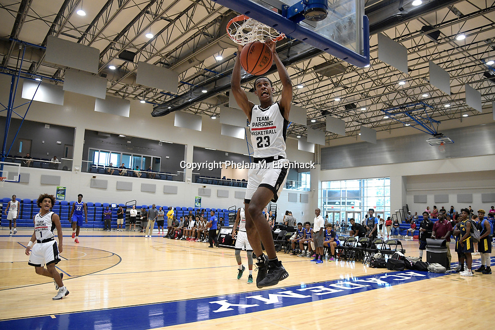 Team Parsons' Dakota Rivers (23) dunks the ball during the first half of a basketball game against the DC Blue Devils at the Source Hoops Festival in Orlando, Fla., Saturday, July 22, 2017. (Photo by Phelan M. Ebenhack)