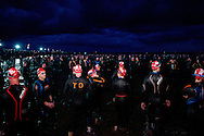 Age Group Competitors prepare for the swim start. 2012 Ironman Melbourne. Asia-Pacific Championship. 25/03/2012. Photo By Lucas Wroe.