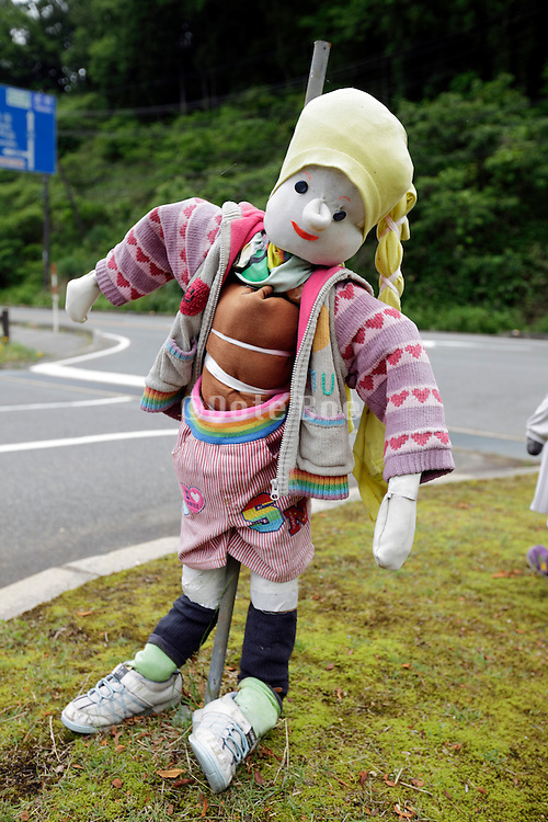 funny stuffed figure at the side of the road