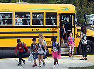 Students exit their school bus as they arrive for the first day of school Tuesday September 5, 2017 at Newtown Elementary School in Newtown, Pennsylvania. (Photo by William Thomas Cain)