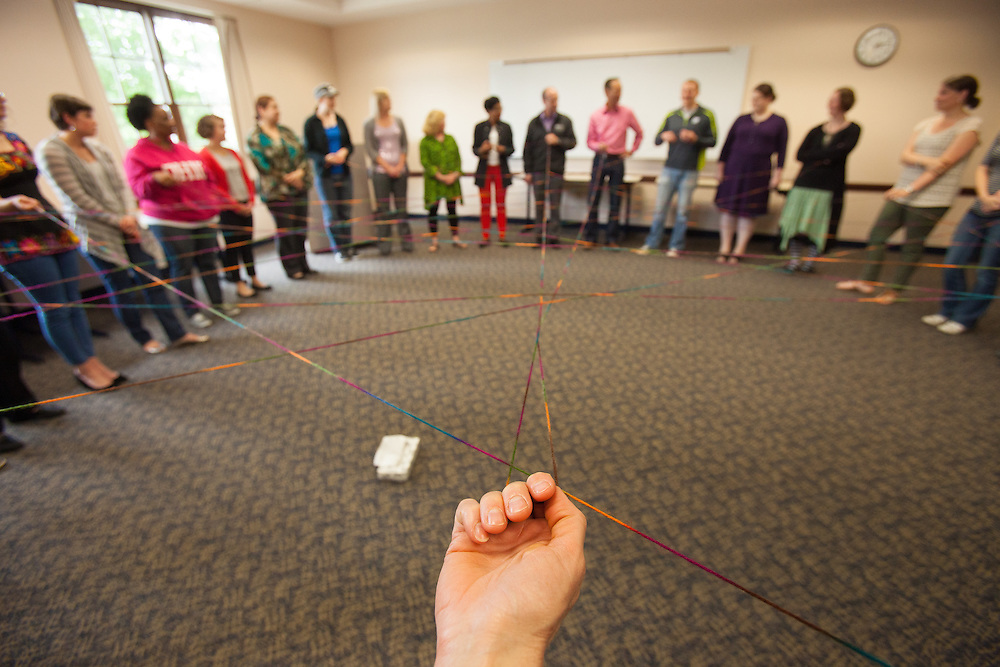 Strands of yarn weaves all of the particpants together during the Web of Affirmation exercise at the Summer Institute for Diversity Education (SIDE) at Ohio University. The programs is designed to promote cross-cultural understanding and inclusiveness.  Photo by Ohio University / Jonathan Adams