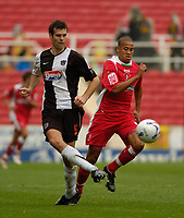Photo: Leigh Quinnell.<br /> Swindon Town v Grimsby Town. Coca Cola League 2. 14/10/2006. Grimsbys Nick Fenton gets the ball away from new Swindon loan signing Alex Rhodes.