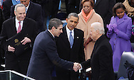 Poet Richard Blanco shakes hands with  Vice President Biden and President Obama at the swearing in ceremony for President Barack Obama at the US Capitol on January 21, 2013.  Photo by Dennis Brack