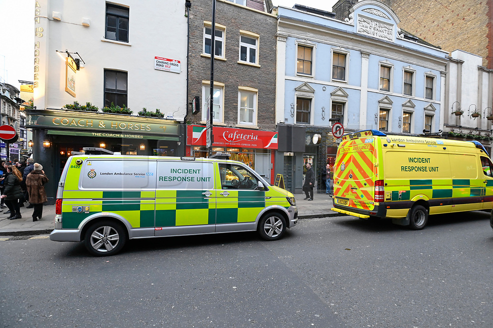 © Licensed to London News Pictures. 03/02/2020. LONDON, UK.  Emergency services on Charing Cross Road.  Scenes in Soho where the public are being evacuated by police and emergency services are in attendance after reports of an unexploded WW2 bomb being discovered in the area.  A wide cordon is being established from Shaftesbury Avenue, Charing Cross Road and the streets around Old Comption Street.  Photo credit: Stephen Chung/LNP