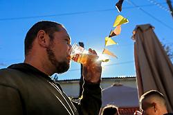 September 30, 2018 - Zaporizhzhia, Ukraine - A man drinks beer from a plastic cup as the sun shines through the beverage at the Beluga Beer Fest in Zaporizhzhia, southeastern Ukraine, September 30, 2018. Ukrinform. (Credit Image: © Dmytro Smolyenko/Ukrinform via ZUMA Wire)