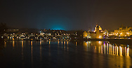 Night view of Charles Bridge (Karlovy Most) with reflections of lights on the Vltava River, Prague, Czech Republic. The image is available for commercial licensing through Arcangel Images. ID# AA1644964 . Contact LOxArte for Fine Art Prints.