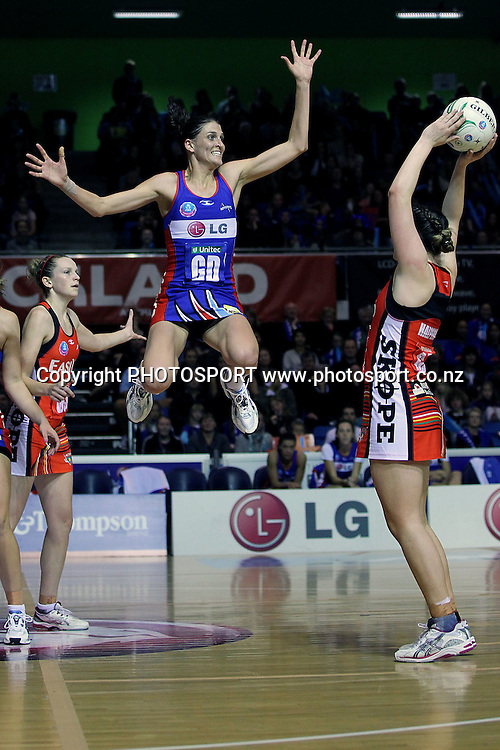 Mystics' Anna Harrison gets high for to pressure the shot from Tactix's Ellen Halpenny. ANZ Netball Championship, Northern Mystics v Canterbury Tactix, Trusts Stadium, Auckland, New Zealand. Sunday 27th May 2012. Photo: Anthony Au-Yeung / photosport.co.nz