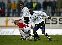 Fotball, 26. april 2003, Tippeligaen, Sogndal-Tromsø 3-1. Raoul Kouakou, Sogndal, og Bjørn Johansen, Tromsø