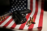 A Ruger 9mm pistol with an American flag is owned by an American citizen who believes in the right to carry and the right to bear arms as protected by the U.S. Constitution on August 5, 2012, in Tucson, Arizona, USA.