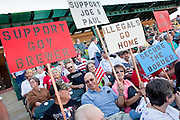 "May 29 - TEMPE, AZ: Opponents of illegal immigration and supporters of Arizona SB070 at a rally in Tempe, AZ. About 3,000 people attended a ""Buy Cott Arizona"" rally at Tempe Diablo Stadium in Tempe, AZ Saturday night. The rally was organized by members of the Arizona Tea Party movement to show support for Arizona law SB1070. The ""Buy Cott"" is a reaction to the economic boycott planned by opponents of SB1070. SB1070 makes it an Arizona state crime to be in the US illegally and requires that immigrants carry papers with them at all times and present to law enforcement when asked to. Critics of the law say it will lead to racial profiling, harassment of Hispanics and usurps the federal role in immigration enforcement. Supporters of the law say it merely brings Arizona law into line with existing federal laws.  Photo by Jack Kurtz"