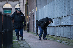 © Licensed to London News Pictures . 29/12/2013 . Manchester , UK . Two officers search the footpath adjacent to the River Medlock off Oxford Road in Manchester City Centre . The search for 17 year old Adam Pickup from Stockport , who was last seen in the early hours of Saturday 28th December in Manchester City Centre following a night out with friends as , this evening (Sunday 29th December 2013), Greater Manchester Police say they have arrested two men in connection with the teenager's disappearance . Photo credit : Joel Goodman/LNP
