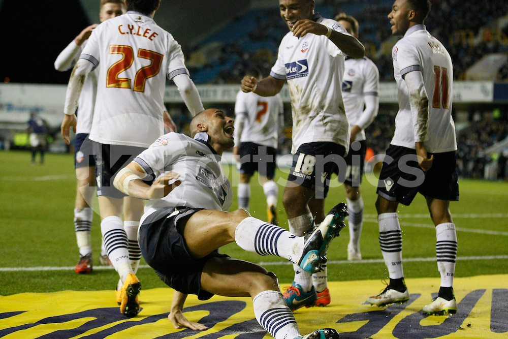 Darren Pratley celebrates his goal with teammates putting Bolton 1-0 up during the Sky Bet Championship match between Millwall and Bolton Wanderers at The Den, London, England on 19 December 2014. Photo by Dave Peters.