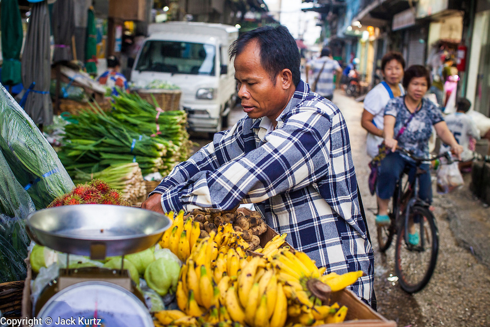 09 OCTOBER 2012 - BANGKOK, THAILAND:  A banana vendor in the Bangkok Flower Market. The Bangkok Flower Market (Pak Klong Talad) is the biggest wholesale and retail fresh flower market in Bangkok. It is also one of the largest fresh fruit and produce markets in the city. The market is located in the old part of the city, south of Wat Po (Temple of the Reclining Buddha) and the Grand Palace.    PHOTO BY JACK KURTZ